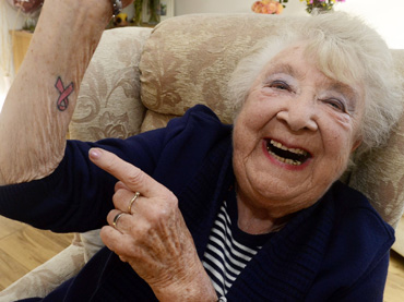 Canterbury-Grandmother-Heather-Brooks-Takes-a-Trip-to-the-Belly-Bar-to-Get-her-First-Tattoo
